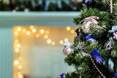 Decorated Christmas tree on blurred, sparkling and fairy background.  Stock Photos