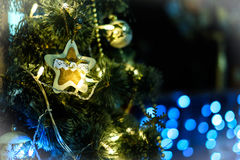 Decorated Christmas tree on blurred, sparkling and fairy background.  Royalty Free Stock Photography