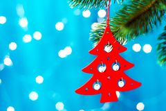 red Christmas tree in the shape of a Christmas tree on a blue background with a bokeh on blurred, sparkling and fairy background stock images