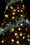 Decorated Christmas tree with bokeh light sparkling in the night stock photography
