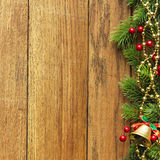 Decorated Christmas tree border on wood paneling Stock Photos