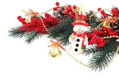 Decorated Christmas tree branch with a burning candle Royalty Free Stock Photography