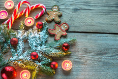Decorated Christmas tree branch with cookies and candies Stock Photography