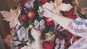 Decorated Christmas tree. Christmas balls, red ribbons, cinnamon stick. Christmas tree using Christmas balls, red ribbons, cinnamon sticks and flowers. Details stock footage