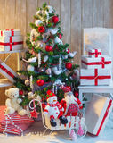 Decorated Christmas tree and christmas gift boxes Stock Images