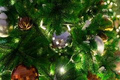 Decorated Christmas tree close up details. Christmas tree lights and toys.  royalty free stock image