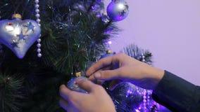 Decorated Christmas tree closeup. illuminated garland with flashlights