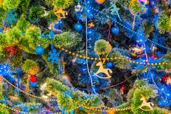 Decorated Christmas tree. Colorful garlands and toys. New year`s holiday.  Stock Image