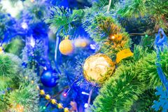 Decorated Christmas tree. Colorful garlands and toys. New year`s holiday.  Stock Photos