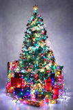 Decorated Christmas tree with colorful lights Stock Photography