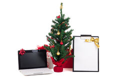 Decorated christmas tree, computer and gift list on white backgr Stock Image