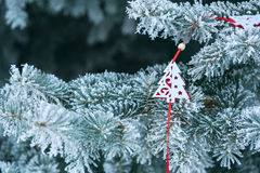 Decorated Christmas tree covered with snow Stock Photo