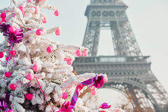 Christmas tree covered with snow near the Eiffel tower in Paris Stock Photography
