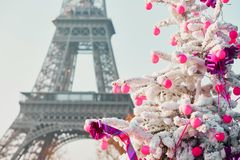 Christmas tree covered with snow near the Eiffel tower in Paris Royalty Free Stock Photography