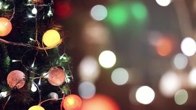 Decorated christmas tree and defocused bokeh background. With flashing lights stock footage