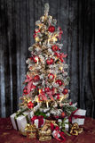 Decorated christmas tree with electric candles and presents Royalty Free Stock Image