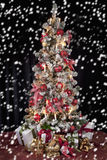 Decorated christmas tree with electric candles and presents Stock Images