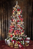 Decorated christmas tree with electric candles and presents Royalty Free Stock Images