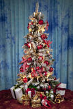 Decorated christmas tree with electric candles and presents Stock Photo