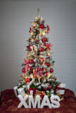 Decorated christmas tree with electric candles and presents Stock Photos