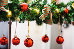 Decorated Christmas tree garland with red balls and bows Stock Image