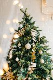 Decorated Christmas Tree garlands and balls lights. Christmas tree decorated with garlands and balls. Vertical shot royalty free stock photography