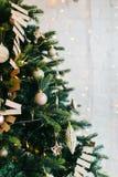 Decorated Christmas Tree garlands and balls lights. Christmas tree decorated with garlands and balls. Vertical shot stock photos