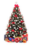 Decorated Christmas tree and gift boxes Royalty Free Stock Images