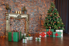 Decorated Christmas tree and gift boxes in living room Royalty Free Stock Photography