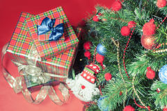Decorated christmas tree with gift boxes and Santa Claus toy Royalty Free Stock Photography