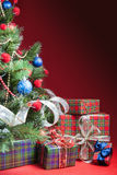 Decorated christmas tree with gift boxes and Santa Claus toy Stock Images