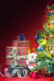 Decorated christmas tree with gift boxes and Santa Clus toy Royalty Free Stock Photo