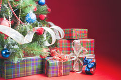 Decorated christmas tree with gift boxes and Santa Clus toy Royalty Free Stock Photography