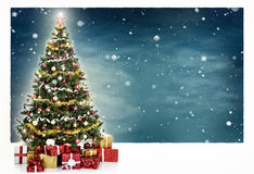 Decorated Christmas tree and gift boxes Stock Images