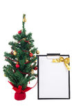Decorated christmas tree and gift list on white background Stock Photos