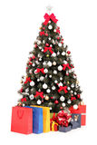 Decorated Christmas tree with gifts and bags Stock Images