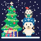 Decorated christmas tree and gifts. Cute polar bear and little funny penguin Vector colorful illustration in flat style Royalty Free Stock Image
