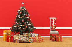 Decorated Christmas tree with gifts. Red room with minimalist chair. Christmas tree decorated in traditional style, surrounded by gift boxes with golden ribbons Royalty Free Stock Photos