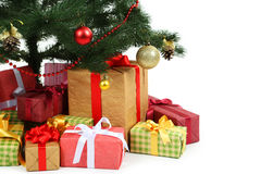 Decorated christmas tree with gifts on white background, close up Stock Image