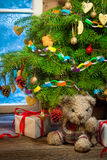 Decorated Christmas tree with gifts in a winter evening Royalty Free Stock Photos