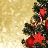 Decorated Christmas tree on glitter background Royalty Free Stock Photos