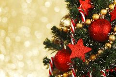 Decorated Christmas tree on glitter background Stock Image