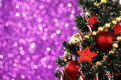 Decorated Christmas tree on glitter background Royalty Free Stock Image