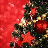 Decorated Christmas tree on glitter background Royalty Free Stock Photography