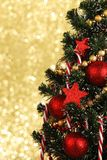 Decorated Christmas tree on glitter background Royalty Free Stock Photo