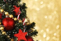 Decorated Christmas tree on glitter background Stock Photography