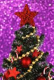 Decorated Christmas tree on glitter background Stock Photos