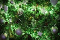Christmas tree. Decorated christmas tree glowing with shiny decorations background Royalty Free Stock Photo