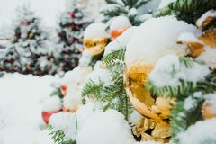 Decorated Christmas tree with golden balls. Outdoor. Xmas card and pattern. Fair. Winter. stock photography