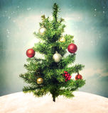 Decorated Christmas tree on hilltop. Decorated Christmas tree on a hilltop in the night Royalty Free Stock Photo